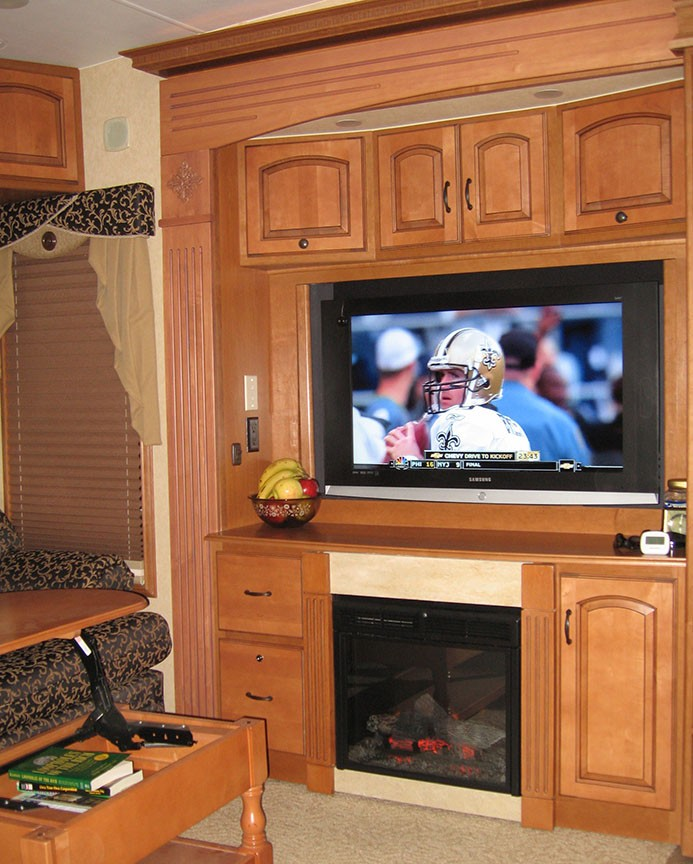 A TV displays a New Orleans' Saints football player warming up.