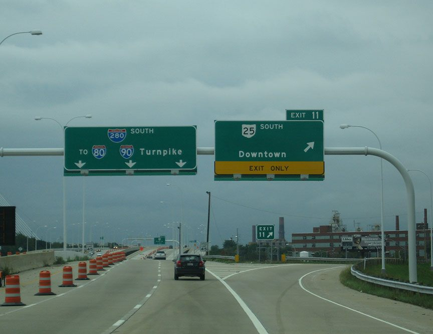Directional signs hang over the freeway through Toledo, Ohio