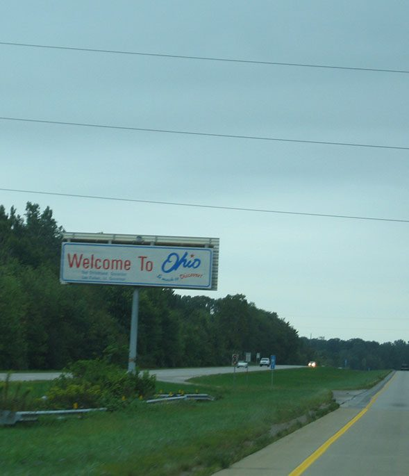 A sign that reads Welcome to Ohio stands in the median of the highway