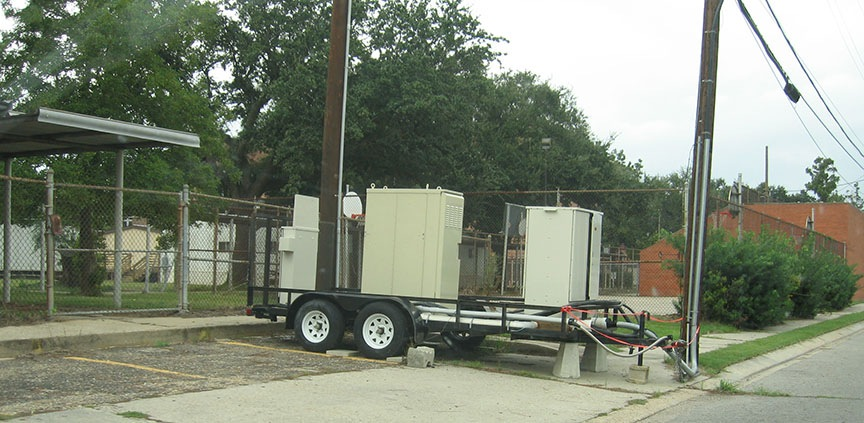 A trailer holds a generator and is parked next to the street in the 9th Ward.