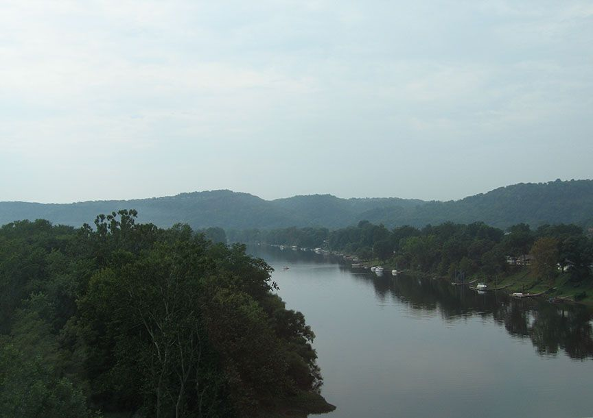 The Potomac River stretches out of the passenger window, rolling hills covered with trees line both banks