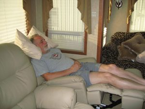 Rick Gifford lays in an extended recliner in the RV, fast asleep.